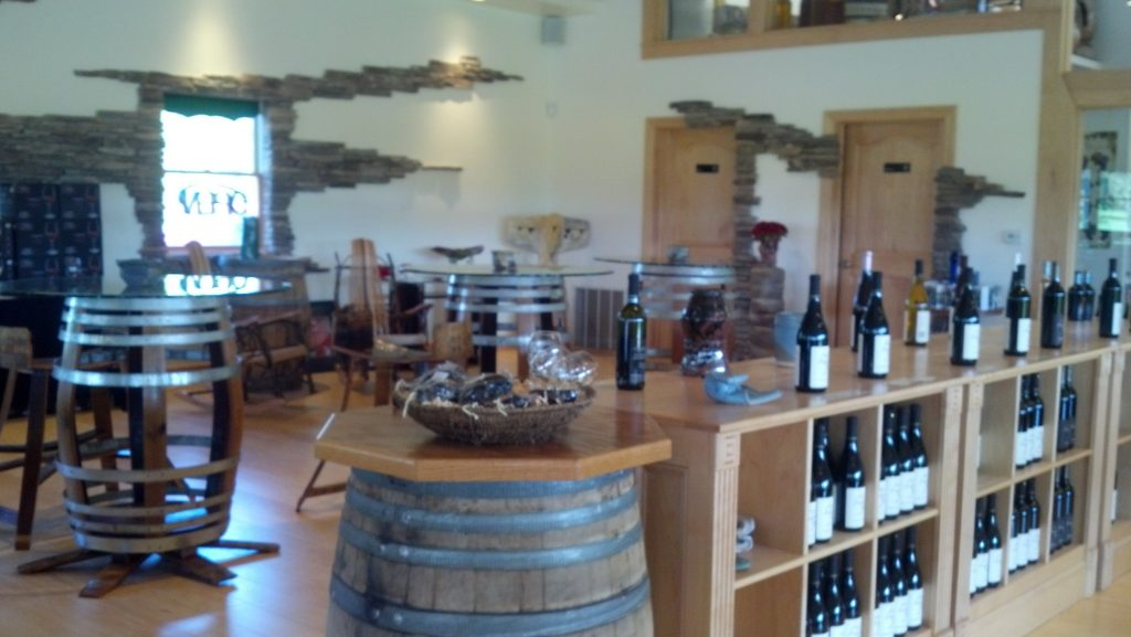 Inside winery, barrels and bottles